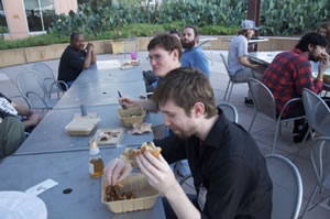 Group of filmmakers eating at a meeting